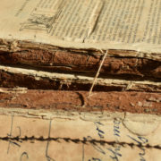 water damaged book spine in decay