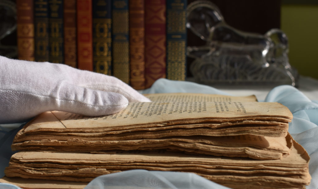 historical book in need of digital preservation receiving white glove handling