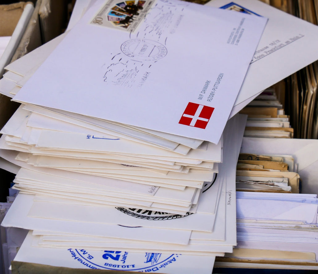 stack of letters from around the world